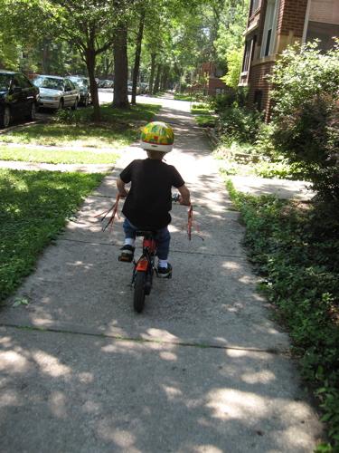 Sam on bike riding away