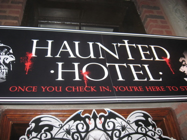 Haunted hotel close up sign