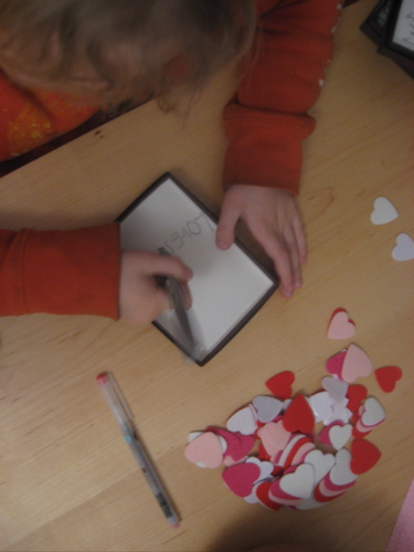 Sam writing valentines
