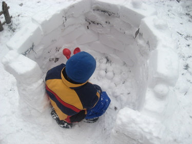 Sam in igloo