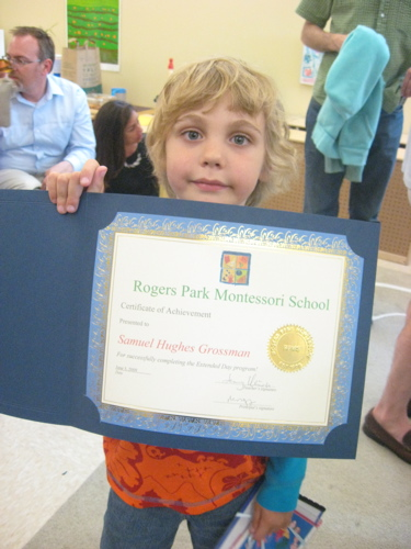 Sam holding diploma