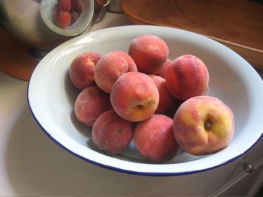 Peaches in blue bowl