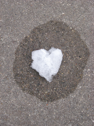 Ice heart on sidewalk