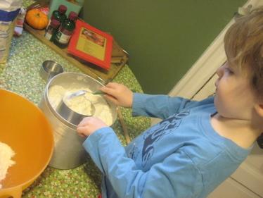 Ben scooping flour