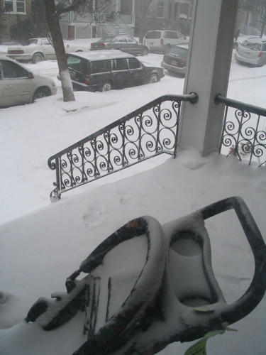 Snow_on_porch_with_stroller